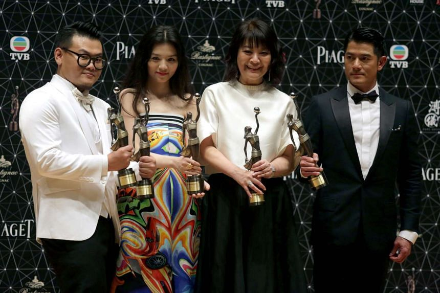 Port Of Call cast with their awards (from far left) Michael Ning, best supporting actor; Jessie Li, best actress; Elaine Jin, best supporting actress; and Aaron Kwok, best actor.