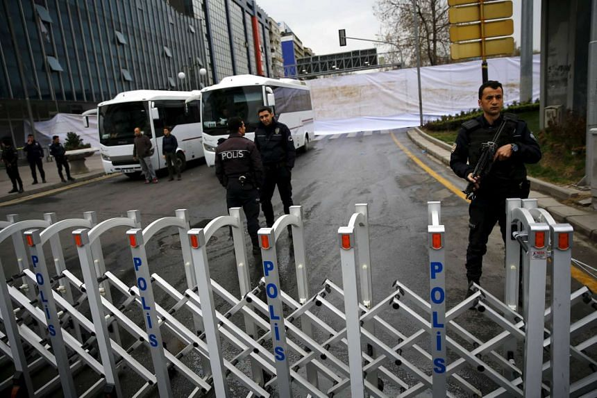 Riot police secure the site of Ankara's suicide bomb attack on March 14, 2016.
