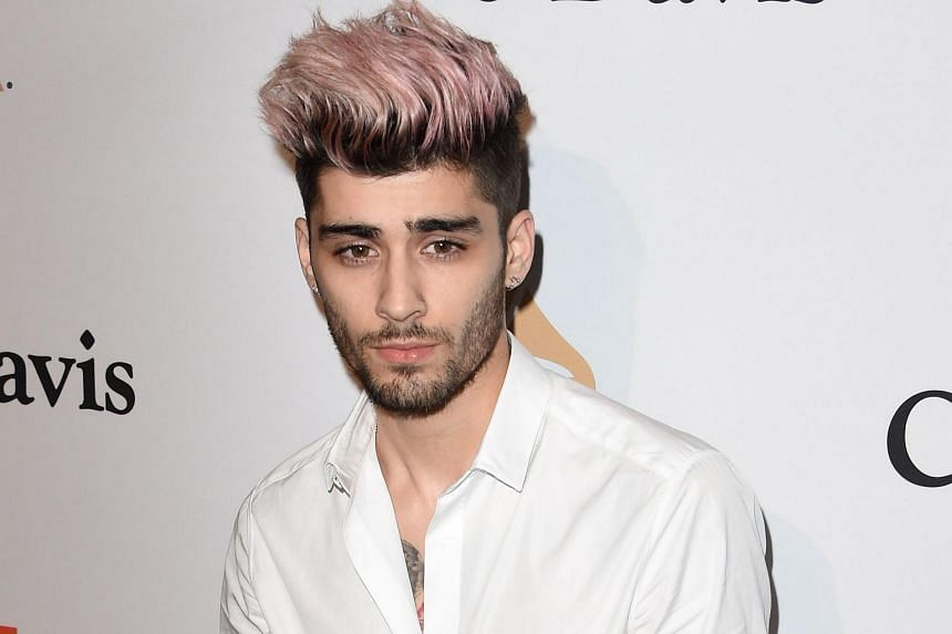 Former One Direction star Zayn Malik's solo debut album opens at No. 1 in both the United States and Britain.
