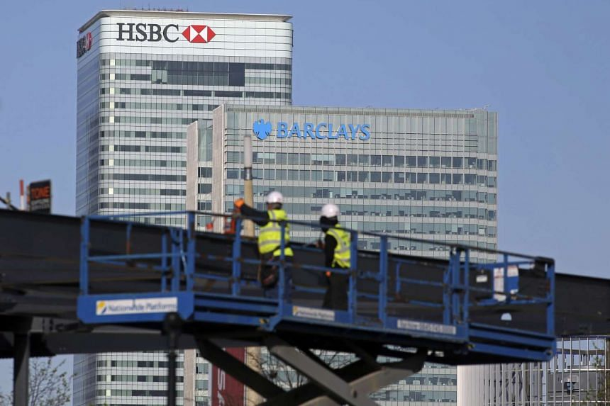 The headquarters of HSBC Holdings and Barclays in London on April 8, 2014.