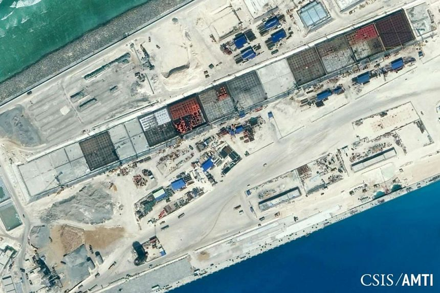 The main infrastructure located on the north-west side of Subi Reef showing a seawall and docks that have been constructed and work continuing on a number of hardened buildings are visible in this Center for Strategic and International Studies (CSIS)
