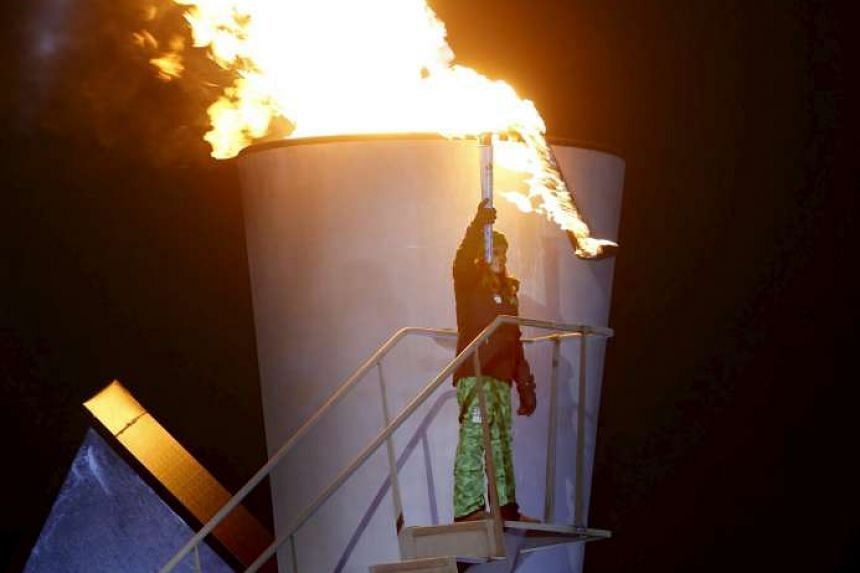 Norway's Princess Ingrid Alexandra lits the Olympic flame during the opening ceremony of the Lillehammer 2016 Winter Youth Olympic Games in Lillehammer, Norway, on Feb 12, 2016.
