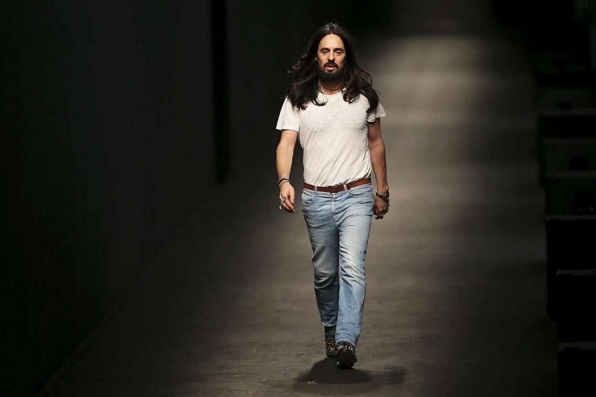 Italian designer Alessandro Michele appears at the end of the Gucci Autumn/Winter 2016 woman collection during Milan Fashion Week, Italy, on Feb 24, 2016.