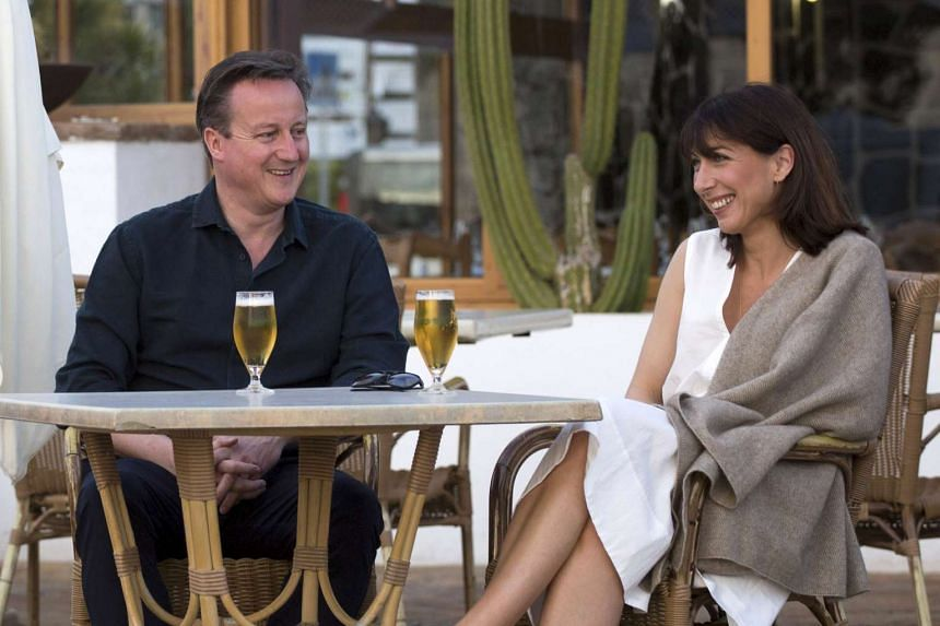 British Prime Minister David Cameron (left) and his wife Samantha pose for a photograph, during their holiday in Playa Blanca, Lanzarote on March 25, 2016.