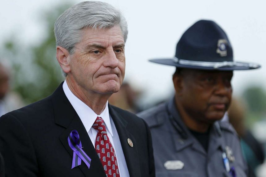 Mississippi Governor Phil Bryant arrives to attend B.B. King's funeral in Indianola, Mississippi in this May 30, 2015, file photo. Bryant on April 5, 2016, signed into law a measure affording wide protections for actions considered discriminatory by
