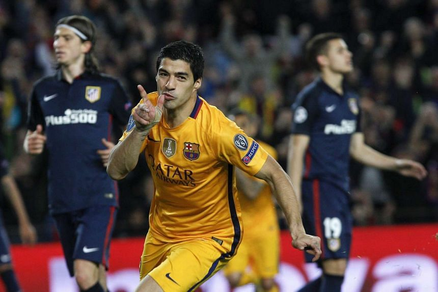 Luis Suarez celebrates after scoring his second goal against Atletico Madrid.