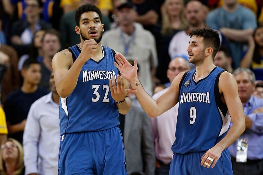 Karl-Anthony Towns (left) of the Minnesota Timberwolves is congratulated by Ricky Rubio after he made a basket against the Golden State Warriors at Oracle Arena on April 5, 2016.