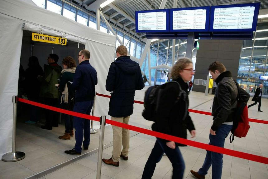 Commuters standing in line at a voting tent at Utrecht Central Station to vote on an EU cooperation deal with Ukraine, on April 6, 2016.