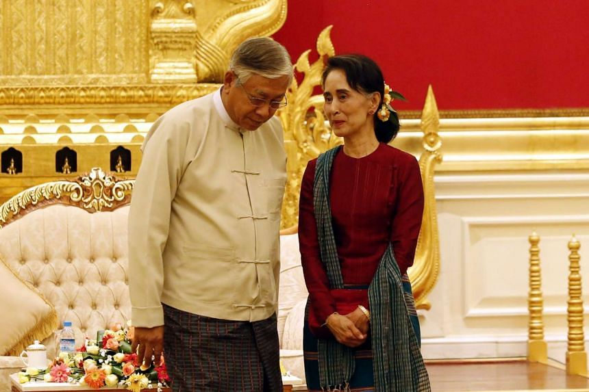 Myanmar's President Htin Kyaw (left) listens to Myanmar's new Foreign Minister Aung San Suu Kyi on April 6, 2016.