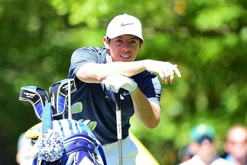 Rory McIlroy studying the green at the Augusta National Golf Club on Monday. The world No. 3 boosted his Masters campaign with an ace at the par three, 16th hole during his practice round .