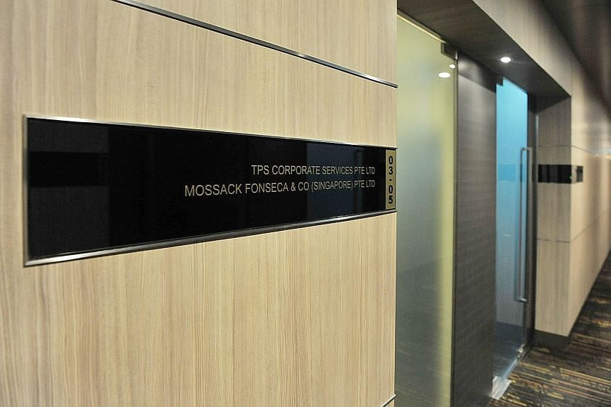 "Mr Mossack (top) and Mr Fonseca of Mossack Fonseca. ""We are going to make ourselves the right size - smaller,"" Mr Fonseca said during a four-hour interview on March 29. Below: The Mossack Fonseca office in Singapore, in Keppel Road."