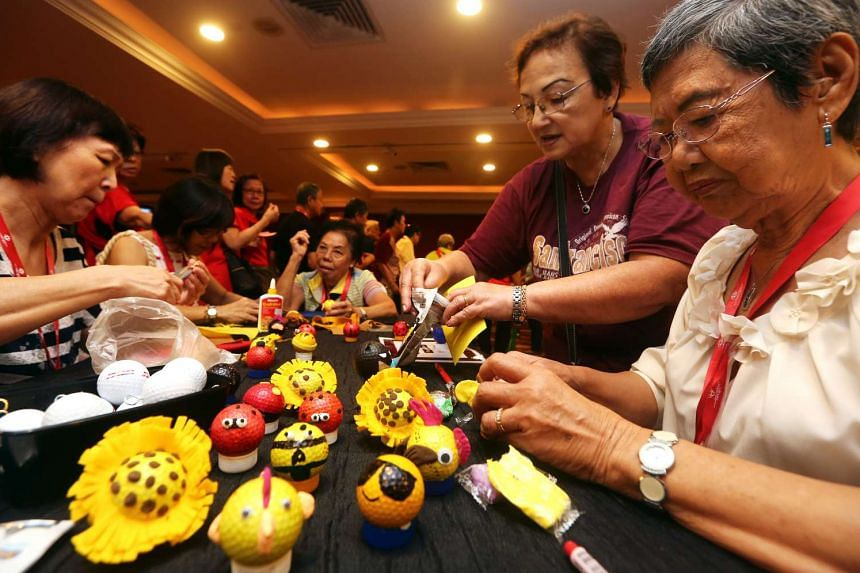 Seniors from Aljunied GRC and Hougang SMC making golf ball ornaments to raise funds for wellness-related programmes in their district, on April 6, 2016.