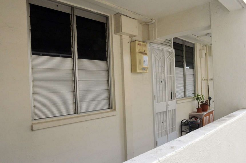 The 28-year-old woman had been found lying motionless in the rented bedroom of the third-floor flat at Circuit Road.