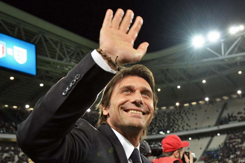 Antonio Conte waving to supporters prior the international friendly football match between Italy and England on March 31, 2015.