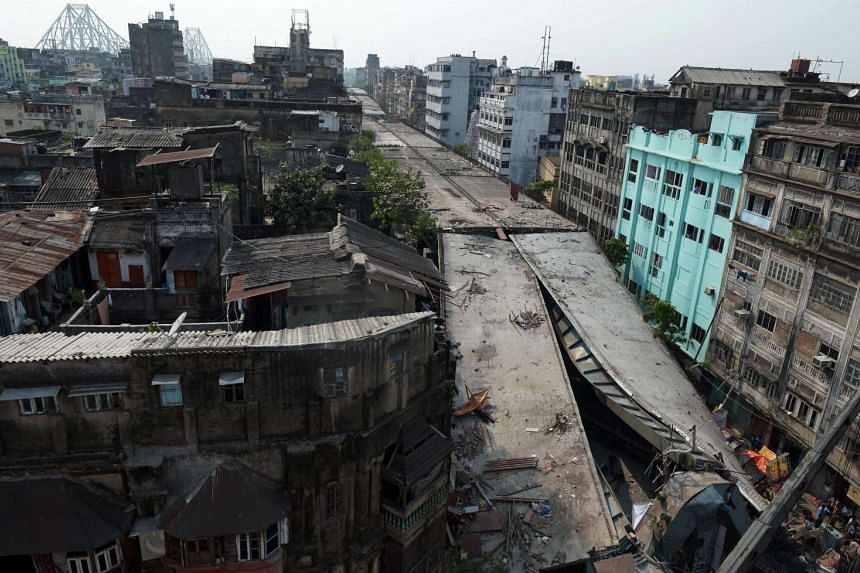 The wreckage of a collapsed flyover bridge in Kolkata on March 31, 2016.