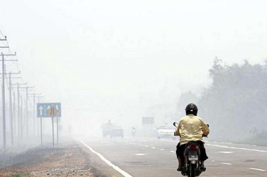 Bush fires causing severe haze in Bongawan near Papar in Sabah.
