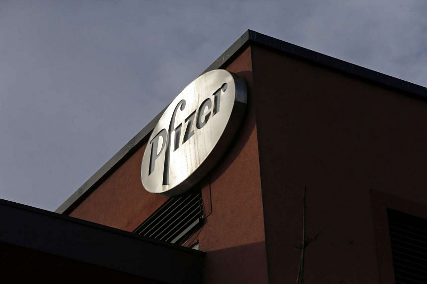 A company logo is seen at a Pfizer office in Dublin, Ireland.