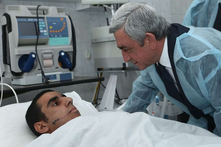 Armenian President Serzh Sarkisian visits a soldier who was wounded in clashes with Azeri forces on April 4, 2016.