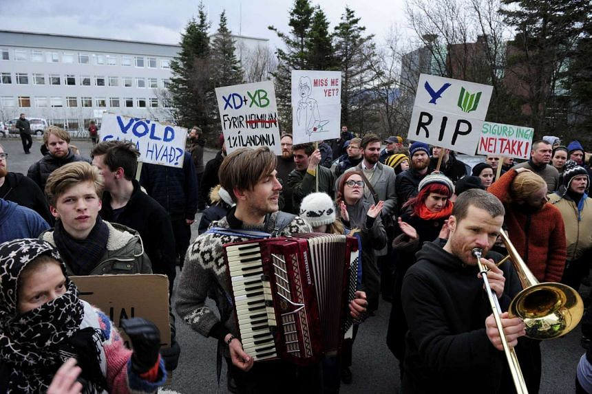 People demonstrate against Iceland's Prime Minister Sigmundur David Gunnlaugsson in Reykjavik on April 5, 2016.
