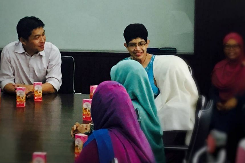 Minister for Social and Family Development Mr Tan and Dr Fatimah (both MPs for Marine Parade GRC) visiting the three students, and staff at Madrasah Al-Maarif Al-Islamiah yesterday. The students were allegedly attacked in separate incidents last week by a