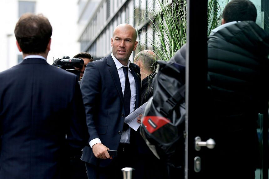 Real Madrid manager Zinedine Zidane arriving at the team's hotel yesterday. His side are the clear favourites to win their Champions League match against Germany's Wolfsburg today.