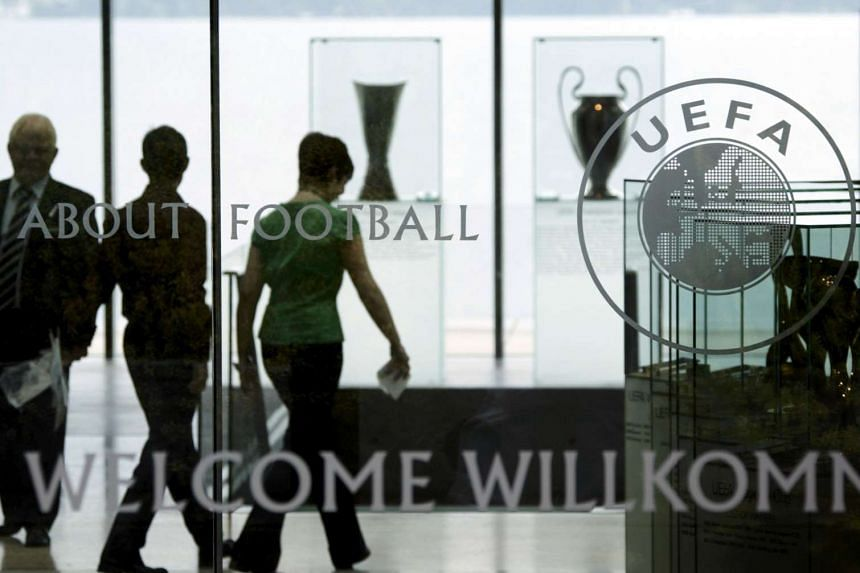 Staff are pictured in the entrance of Uefa's Swiss headquarters in a file photo.