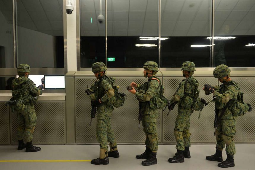 NSmen queueing to return their empty magazines after a firing exercise at the SAF's Multi-Mission Range Complex.