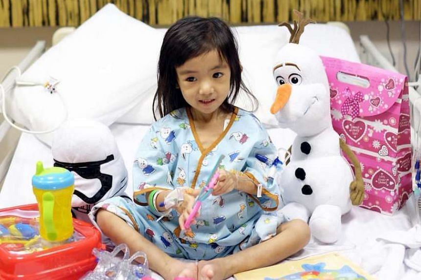 Three-year-old Caitlin Soleil Lucas in her bed at NUH while undergoing treatment.