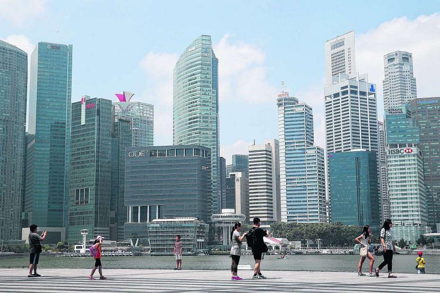 Tourists walking along Marina Bay Sands.