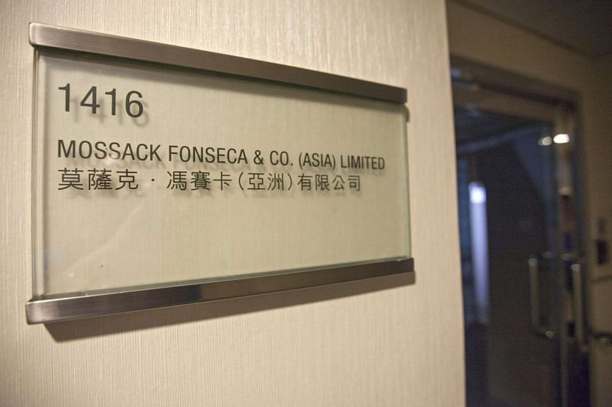 A company signboard is seen outside the Hong Kong offices of Panama-headquartered law firm Mossack Fonseca, Hong Kong, China, on April 4, 2016. Nearly a third of the business of the law firm at the centre of the Panama Papers scandal came from its of