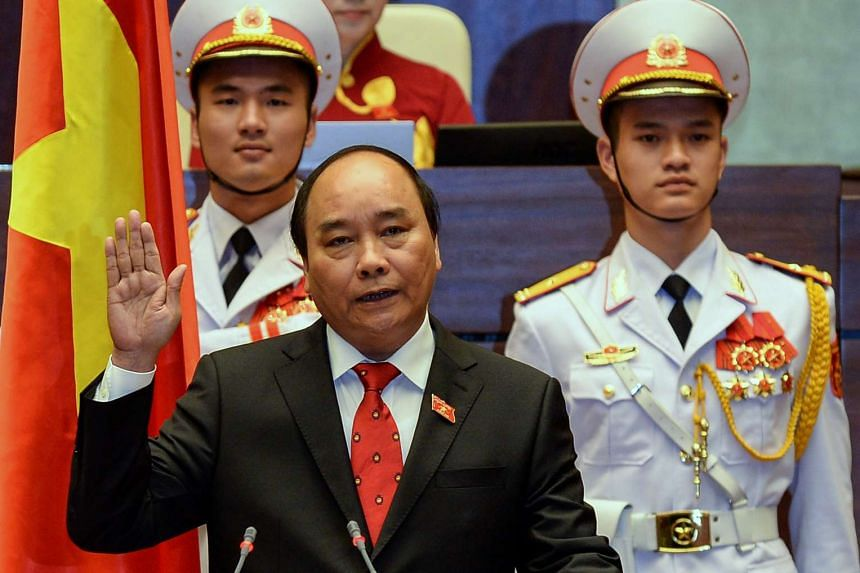 Newly elected Vietnamese Prime Minister Nguyen Xuan Phuc is sworn in during a ceremony at parliament house in Hanoi on April 7, 2016.