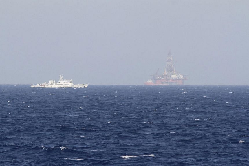 Vietnam has demanded China move a controversial oil rig and abandon plans to start drilling in waters where jurisdiction is unclear.