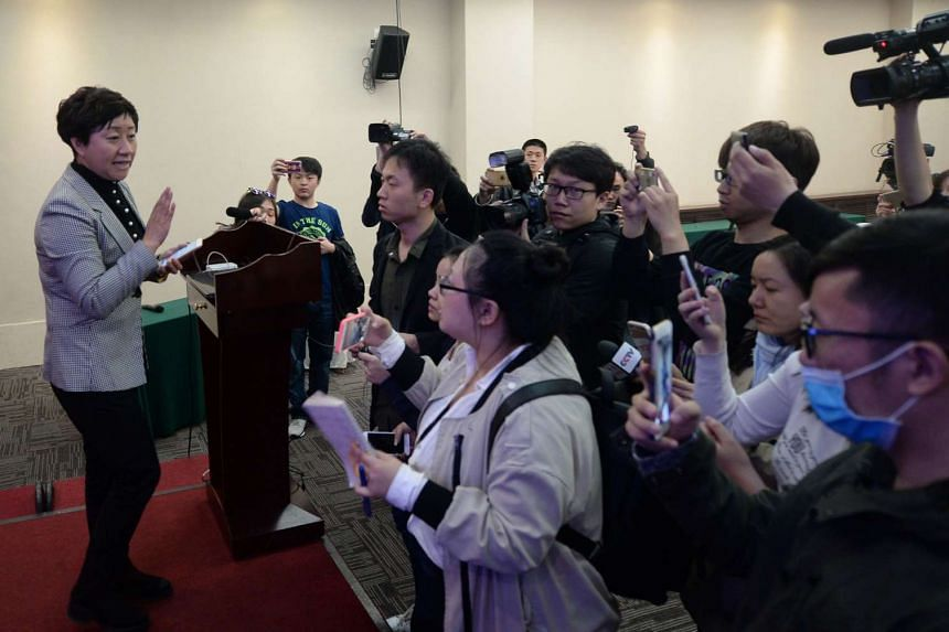 Yitel hotel manager Liu Hongni (left) speaking with the media during a press conference in Beijing on April 6, 2016.