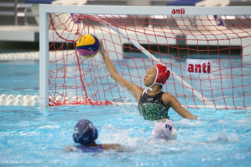 Raffles Institution goalkeeper Samantha Ang makes a save against St Andrew's Junior College in the A division girls' waterpolo final.