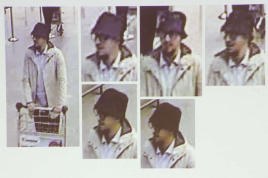 A photo presented by Belgian Federal prosecutors shows a suspect wanted in connection with the Brussels attacks of March 22, 2016, during a press conference two weeks after terror attacks, at the Federal Prosecutor office in Brussels, Belgium, on Apr