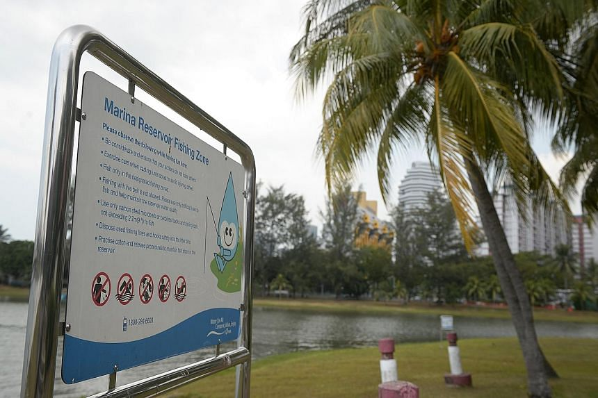 A notice board informing anglers about responsible fishing is seen at a designated fishing area along the Kallang River, where a wild otter pup was spotted last Saturday with a fish hook near its eye.