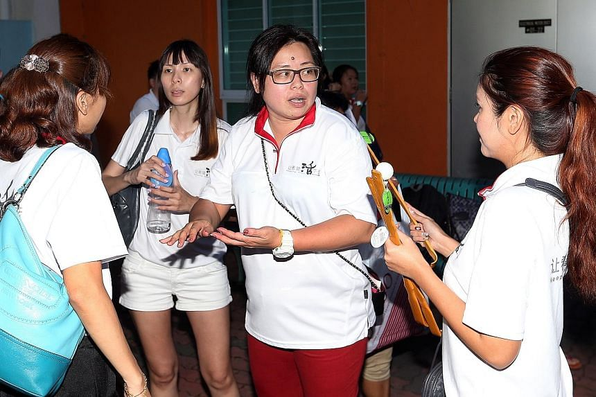 Keeping Hope Alive's founder, Ms Phua (centre), and her fellow volunteers visit estates around the island, spending a few weeks at each. If flats need cleaning, they roll up their sleeves and get started. If light bulbs need to be changed, they do it