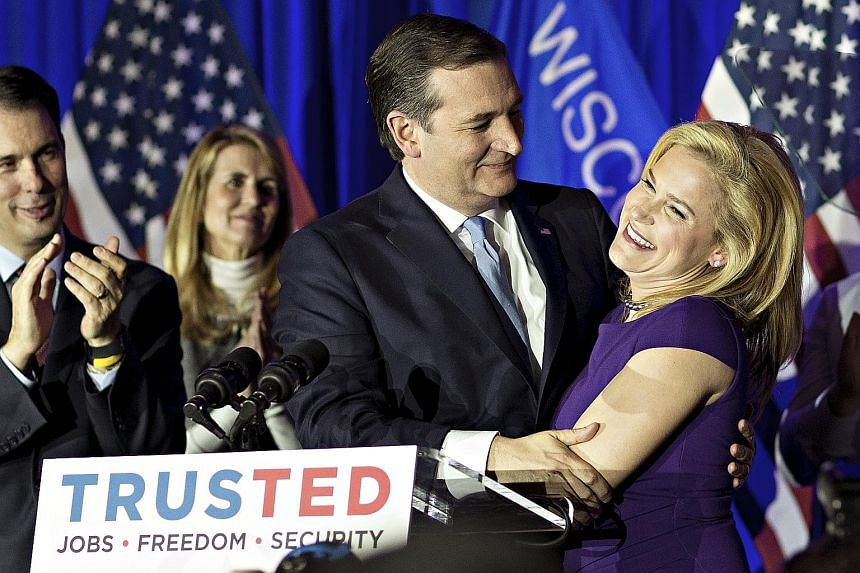 Democratic presidential candidate Bernie Sanders celebrating his victory in Wisconsin. Experts had predicted his win because of the state's open primary rules, large white population and young progressive electorate. Senator Ted Cruz with his wife He