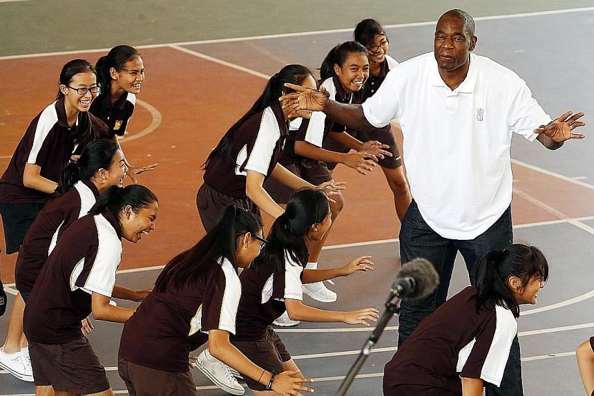 National Basketball Association (NBA) Hall-of-Famer Dikembe Mutombo making practice fun as he conducted a basketball clinic at Dunman Secondary School yesterday. The NBA global ambassador, who is known for his humanitarian work off the court, is in t