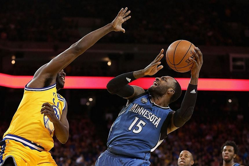 Minnesota's Shabazz Muhammad going up for a shot against Golden State's Draymond Green at the Oracle Arena. The Warriors crashed to their second home defeat in three games, losing the game 117-124.