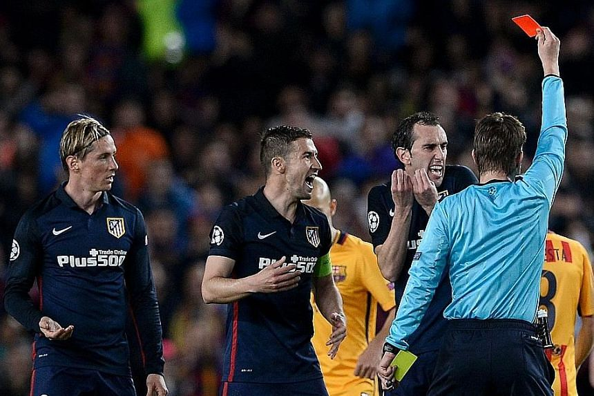 Luis Suarez scoring the second goal for Barcelona at the Nou Camp. Atletico, who played the Champions League match with 10 men for over an hour, say the Uruguayan was lucky to stay on the pitch despite multiple incidents. German referee Felix Brych s