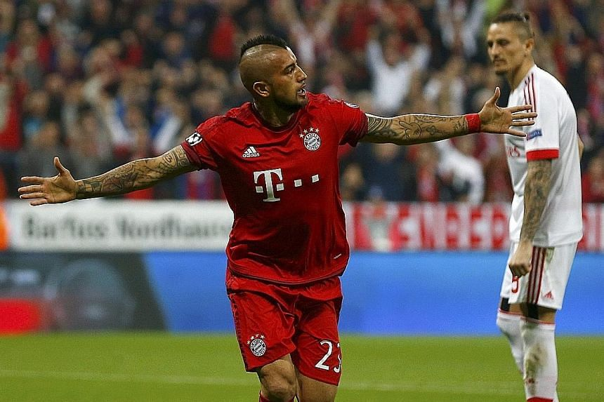 Bayern Munich's Arturo Vidal celebrating after scoring the only goal of their Champions League quarter-final, first-leg match against Benfica at the Allianz Arena.