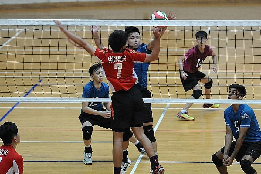 St Hilda's B Division boys (in blue) defeated Fairfield Methodist School 2-0 (25-18, 25-15) in the final to clinch their 15th title in 20 years.