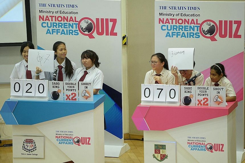 The trio from Yishun Junior College (left) competing against the Serangoon Junior College team yesterday. YJC scored the highest in the first round of The Straits Times-Ministry of Education National Current Affairs Quiz. The team went home with vouc