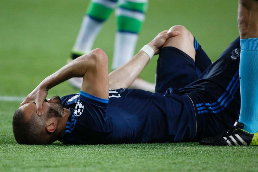 Real Madrid's French forward Karim Benzema lays injured during the match.