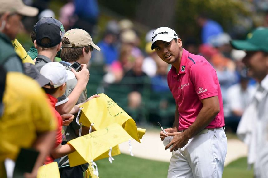 Australia's Jason Day signs autographs during the Par 3 contest prior to the start of the 80th Masters.