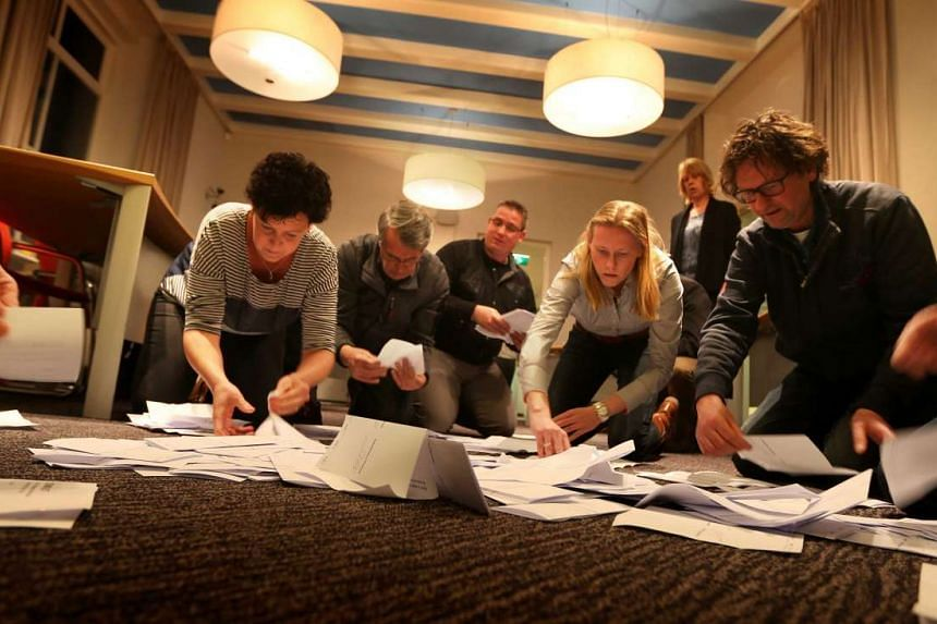 Officials count the votes of the Dutch referendum about the association agreement between the EU and Ukraine.