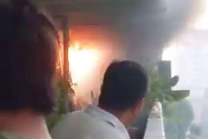 A series of explosions were heard during a fire outside a Eunos Crescent flat.