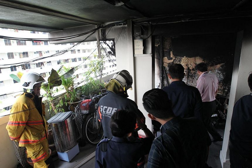 The Singapore Civil Defence Force at the scene, where a fire broke out outside a seventh-floor HDB flat in Eunos Crescent.