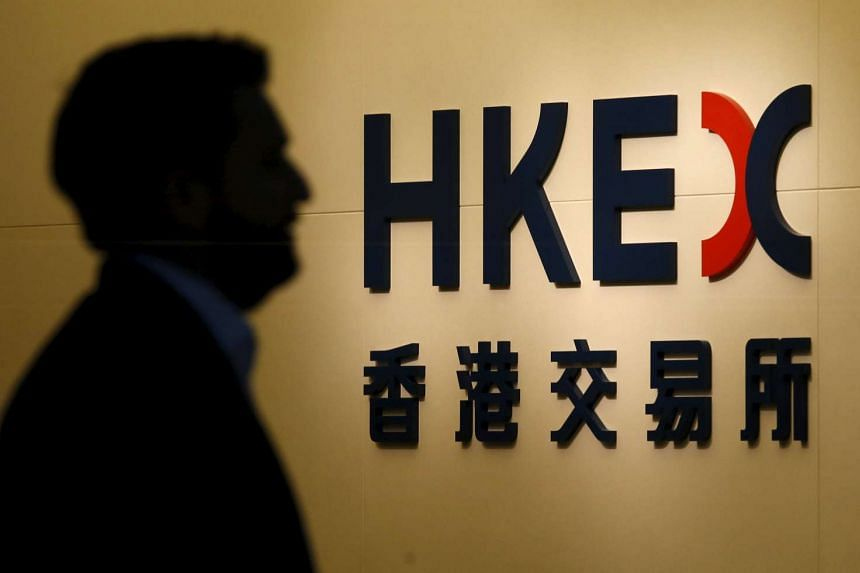 A man walks past the entrance to the Hong Kong Exchanges and Clearing (HKEx).